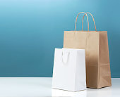Paper shopping bags on table empty copy space.