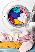 Washing or drying machine loaded with the laundry. Washing, spring cleaning idea