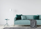 living room with a mint sofa and table