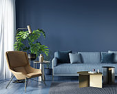 Living room with blue sofa and yellow  armchair
