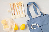 Zero waste kit. Set of eco friendly bamboo cutlery, mesh cotton bag, reusable coffee tumbler, brushes and water bottle. Sustainable, ethical, plastic free