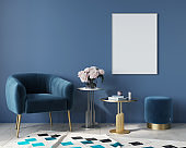 Blue interior with velvet armchair and metal tables