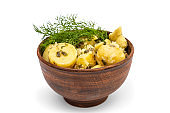 Bowl with boiled potatoes and and dill isolated on white.