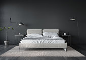 Bedroom interior with white bed and dark gray wall