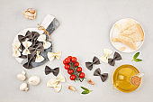 Flat lay with  traditional italian pasta farfalle and cooking ingredients. Traditional italian cusine concept.