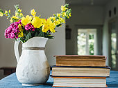 Beautiful flowers lying on a wooden table