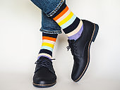 Men's legs, trendy shoes and bright socks