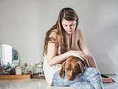 Stylish woman and a charming puppy. Close-up