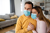 Couple home isolation auto quarantine wearing face mask protective for spreading of disease virus