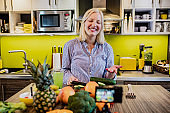 Young woman vlogging about healthy cooking