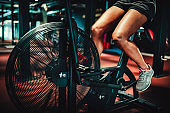 Fit woman working out on the exercise bike at the gym