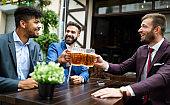 People, men, leisure, friendship and celebration concept