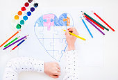 Colorful drawn heart on white background.