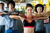 Picture of cheerful fitness team people in gym