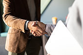 Business handshake and business people concept. Partnership, deal, agreement.