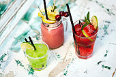 Exotic cocktails, fresh cold alcohol drinks at summer