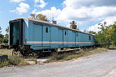 Old freight wagon on the railway isolated