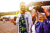 Couple with beer at music festival.