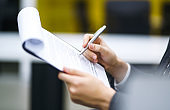 A man signs a contrac, legal or business agreements.