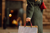 Many Shopping bags in the hand. Autumn shopping.