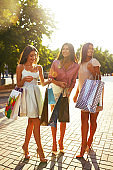Young girls with shopping bags in the city.