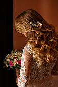 Wedding hairstyle for curly bride