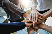 Teamwork Success.  Business people group team happy showing teamwork and joining hands after meeting partner business in office. Business Concept