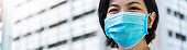 Young Beautiful Asian traveler woman wearing blue protective face mask