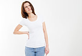 Woman back pain - female rheumatism and its treatment Attractive female person suffers from backache. All on white background.
