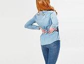 Young red hair woman holding his neck in pain. Medical concept.