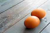 Brown eggs on a wooden table
