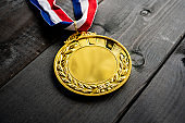Gold medal on wood table background