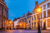 Historic houses on the Pieterskerkhof in the old city center of Leiden, The Netherlands