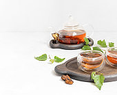 Chaga tea in transparent bowls on a white background. Infusion with birch mushroom.