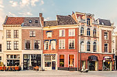View at a historic square with bars, restaurants and shops in the ancient city center of the Dutch city of Zutphen