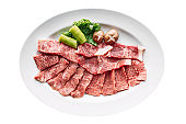 Isolated of Premium Rare Dry-Aged beef with high-marbled texture marinated with pepper and salt on white plate served for Yakiniku