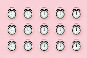 Pattern with black alarm clock on pink background. Minimal style Top view Template for your text, design