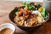 Steam rice with Chicken Satay and fried egg served with salad including green oak and tomato. Served with Satay sauce.