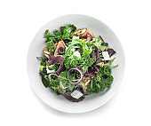 Plate with tasty vegetable salad on white background