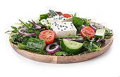 Plate with healthy salad on white background