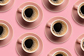 Cups of hot coffee on color background