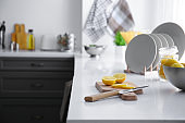 Fresh lemon with cutting board on table in kitchen
