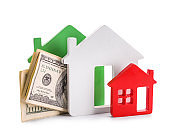 Figures of houses and money on white background. Concept of buying real estate