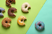 Sweet tasty donuts on color background
