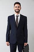 Handsome businessman on light background