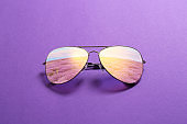 Reflection of lavender field in sunglasses on color background
