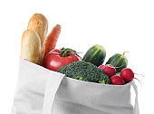 Eco bag with products on white background, closeup