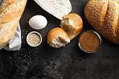 Bakery products with ingredients for dough on grey background
