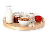 Tray with tasty breakfast on white background