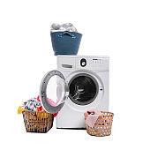 Modern washing machine and laundry on white background